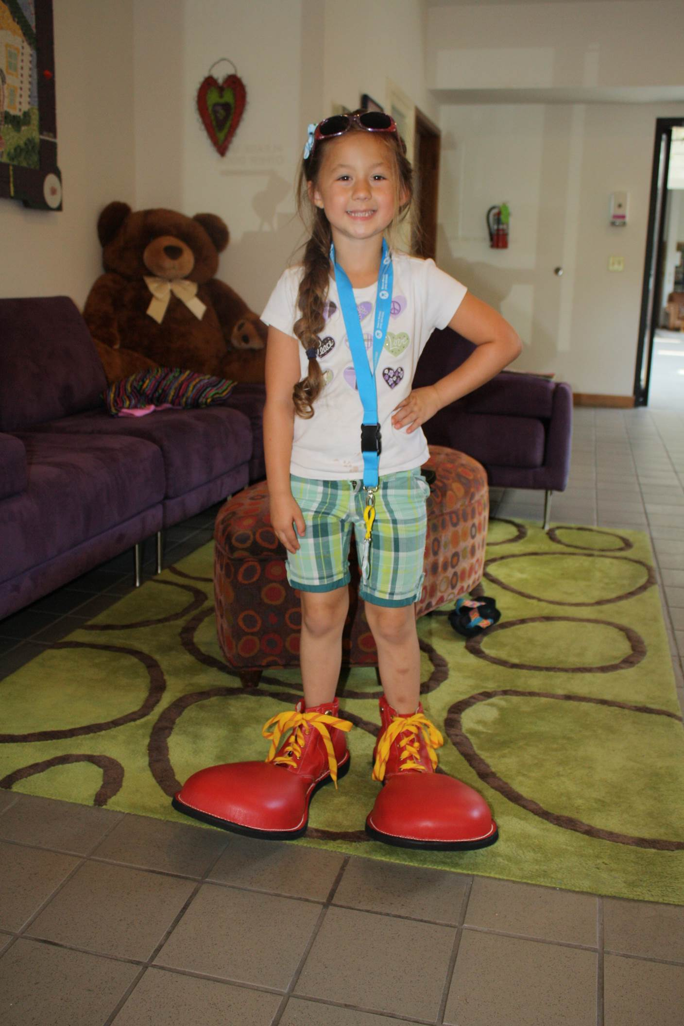 Girl wearing Ronald McDonald's Red Shoes